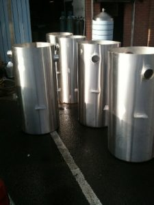 Large Stainless Steel Grease Traps lined up ready for dispatch